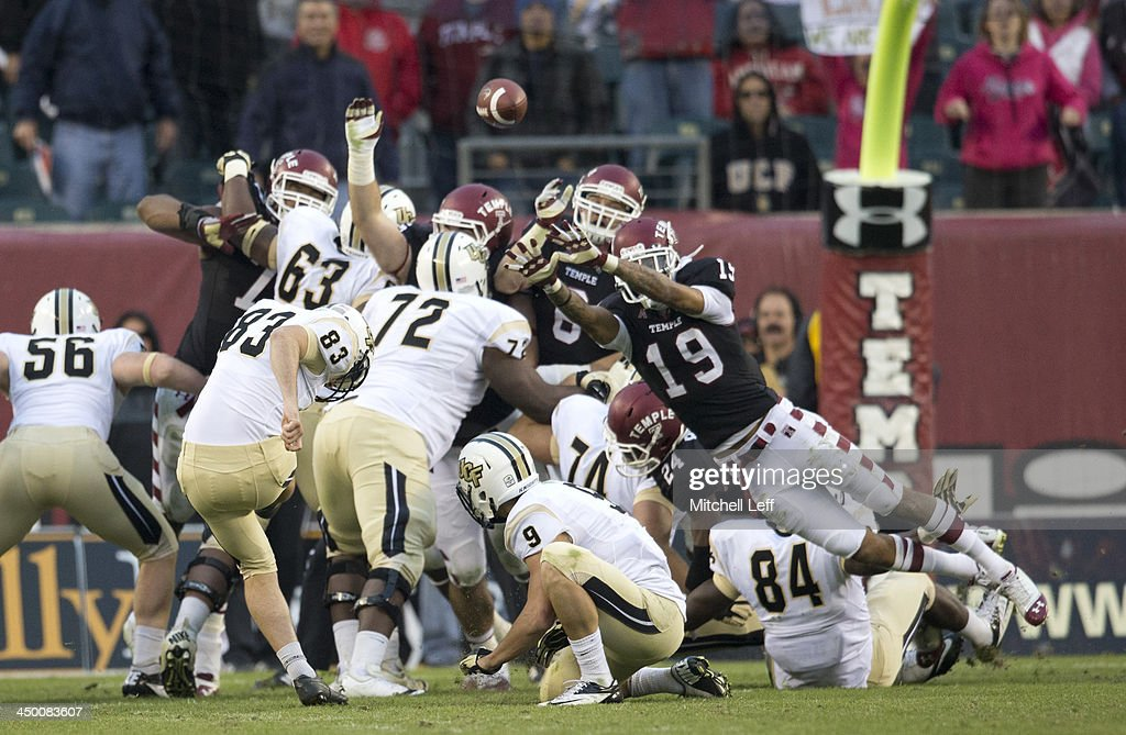 Place Kicker Shawn Moffitt #83 of the University of Central Florida Knights kicks the game winning field goal against the Temple University Owls on November 16, 2013 at Lincoln Financial Field in Philadelphia, Pennsylvania.