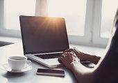 Male hands on laptop keyboard