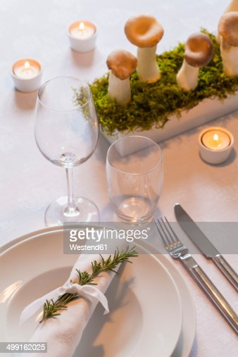 Place setting and decoration on festive laid table