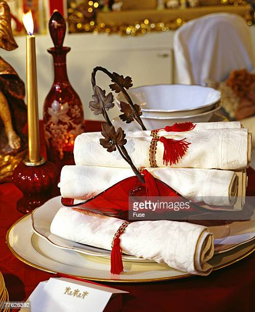 Place Setting and Napkins on Table Decorated for the Holidays