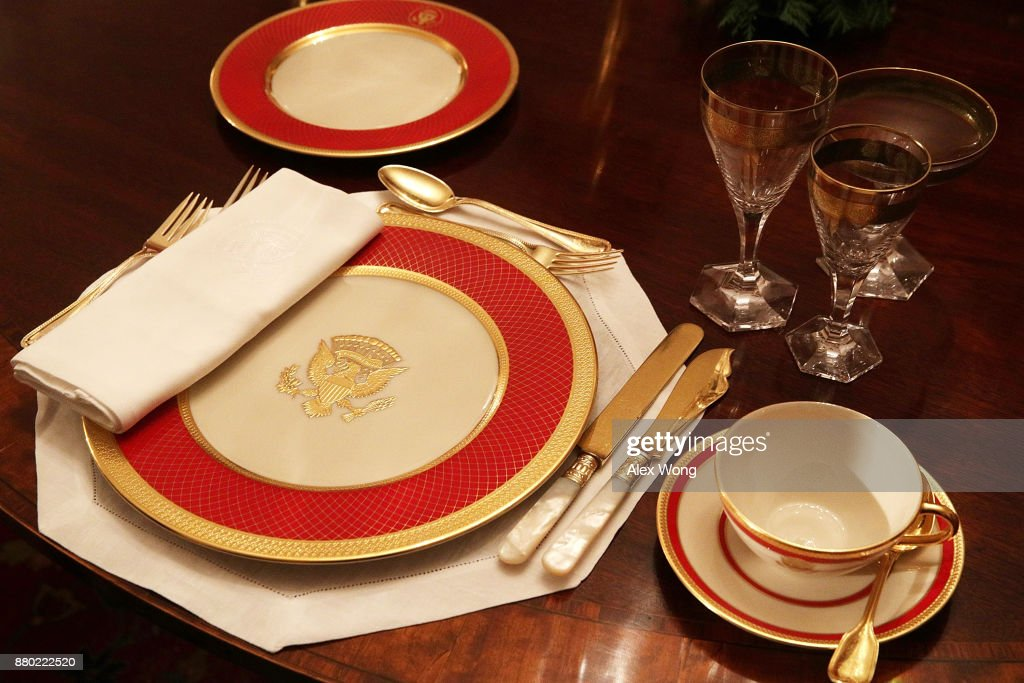 Place setting is seen on a dining table in the China Room at the White House during a press preview of the 2017 holiday decorations November 27, 2017 in Washington, DC. The theme of the White House holiday decorations this year is 'Time-Honored Traditions.'