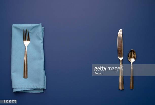 Place Setting on Blue Background with Space for Your Plate