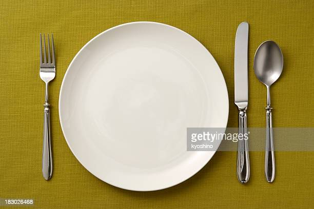 Place setting on green tablecloth