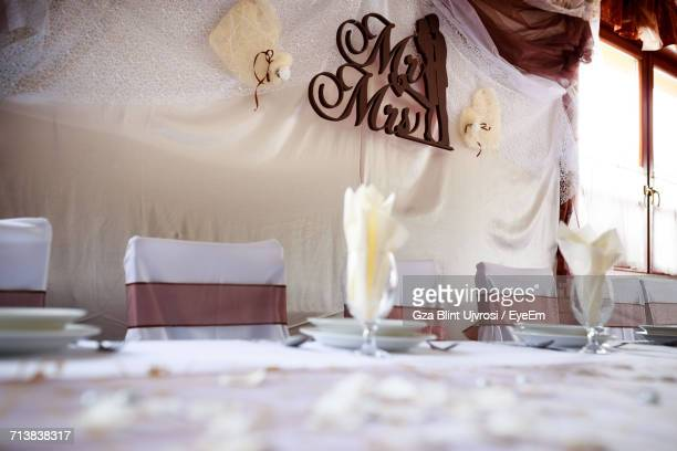 Place Setting On Table By Chairs At Wedding Ceremony