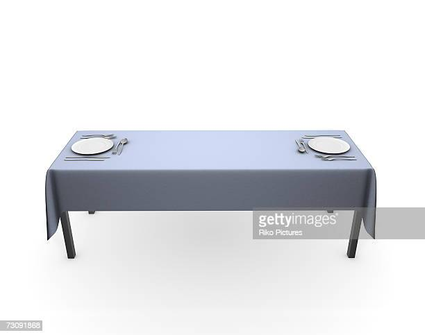 Place settings at opposite ends of long table