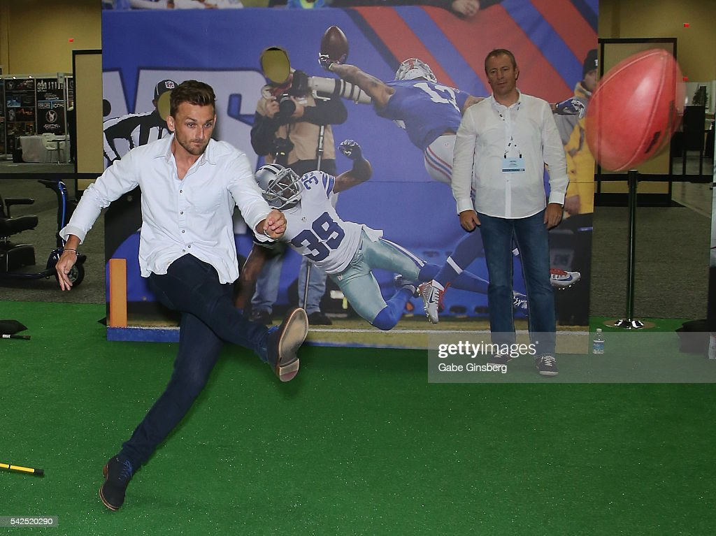 Placekicker Blair Walsh of the Minnesota Vikings kicks a football at targets at the NFLPA Sports Activation Zone during the Licensing Expo 2016 at...