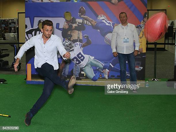 Placekicker Blair Walsh of the Minnesota Vikings kicks a football at targets at the NFLPA Sports Activation Zone during the Licensing Expo 2016 at...