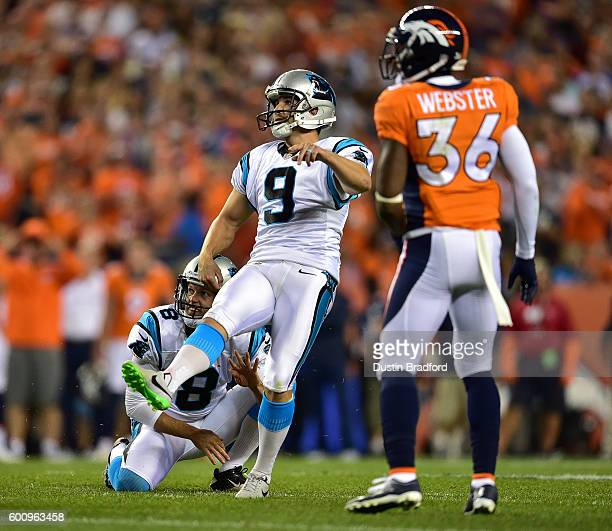 Placekicker Graham Gano and punter Andy Lee of the Carolina Panthers watch as an attempted gamewinning field goal misses to lose to the Denver...