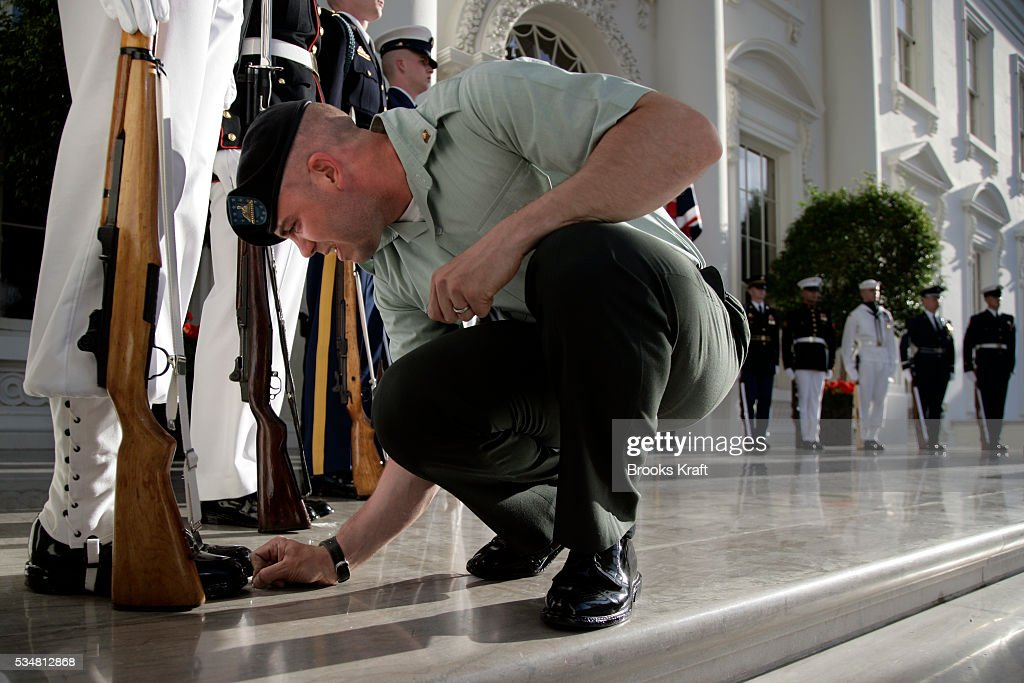 Places are marked in chalk during a dress rehersal for the Military Honor Guard for the arrival of Britain's Queen Elizabeth II at the North Portico...