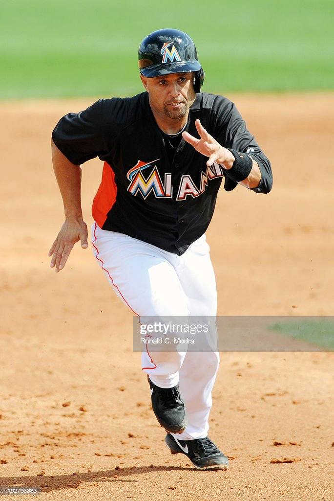 Placido Polanco #30 of the Florida Marlins runs to third base during a spring training game against the St. Louis Cardinals at Roger Dean Stadium on February 23, 2013 in Jupiter, Florida.