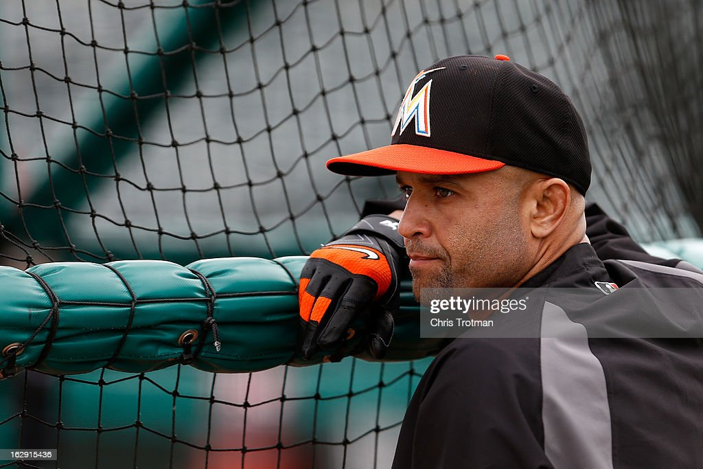 Placido Polanco #30 of the Miami Marlins at looks on during batting practice prior to the game against the St. Louis Cardinals at the Roger Dean Stadium on February 28, 2013 in Jupiter, Florida.