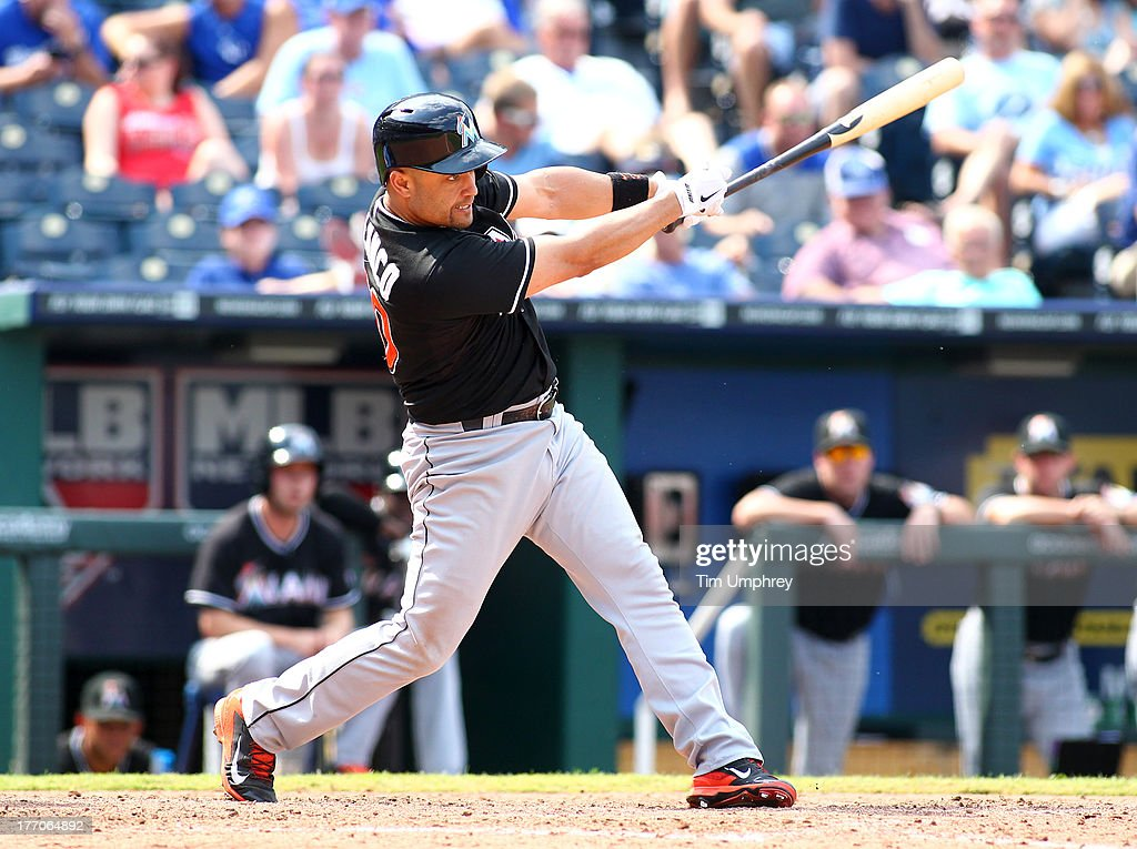 Placido Polanco of the Miami Marlins bats in a game against the Kansas City Royals at Kauffman Stadium on August 14 2013 in Kansas City Missouri The...