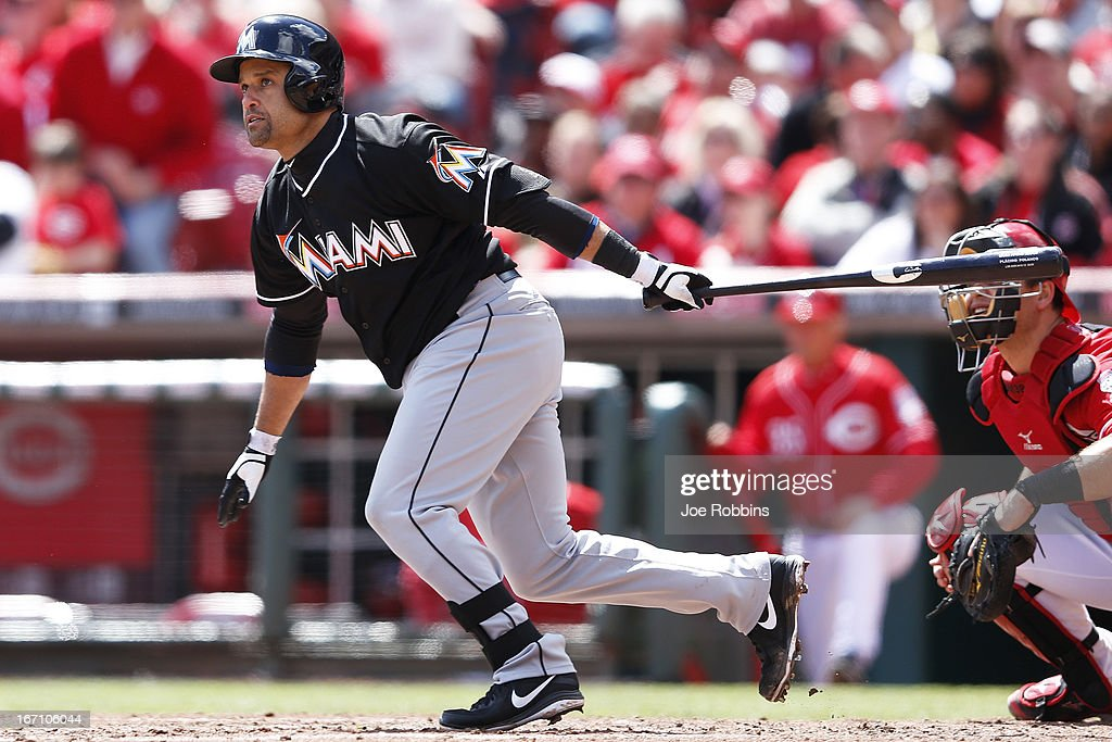 <a gi-track='captionPersonalityLinkClicked' href=/galleries/search?phrase=Placido+Polanco&family=editorial&specificpeople=213170 ng-click='$event.stopPropagation()'>Placido Polanco</a> #30 of the Miami Marlins doubles to drive in the tying run in the fifth inning of the game against the Cincinnati Reds at Great American Ball Park on April 20, 2013 in Cincinnati, Ohio. The Reds won 3-2 in 13 innings.
