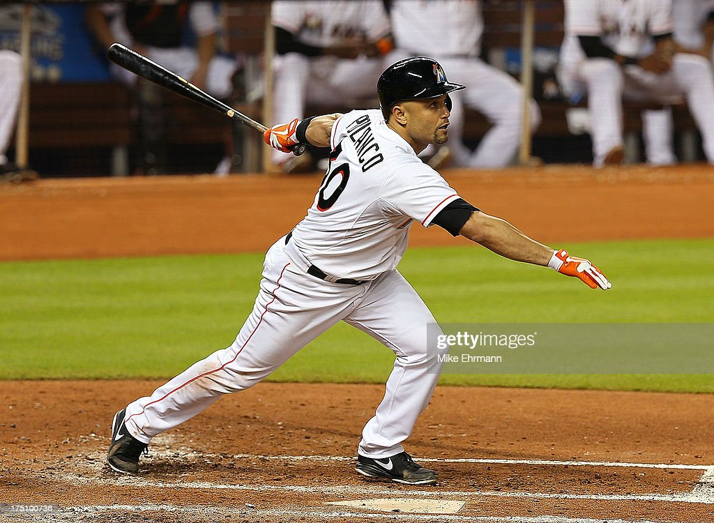 Placido Polanco #30 of the Miami Marlins hits an RBI sacrafice fly during a game against the New York Mets at Marlins Park on July 31, 2013 in Miami, Florida.