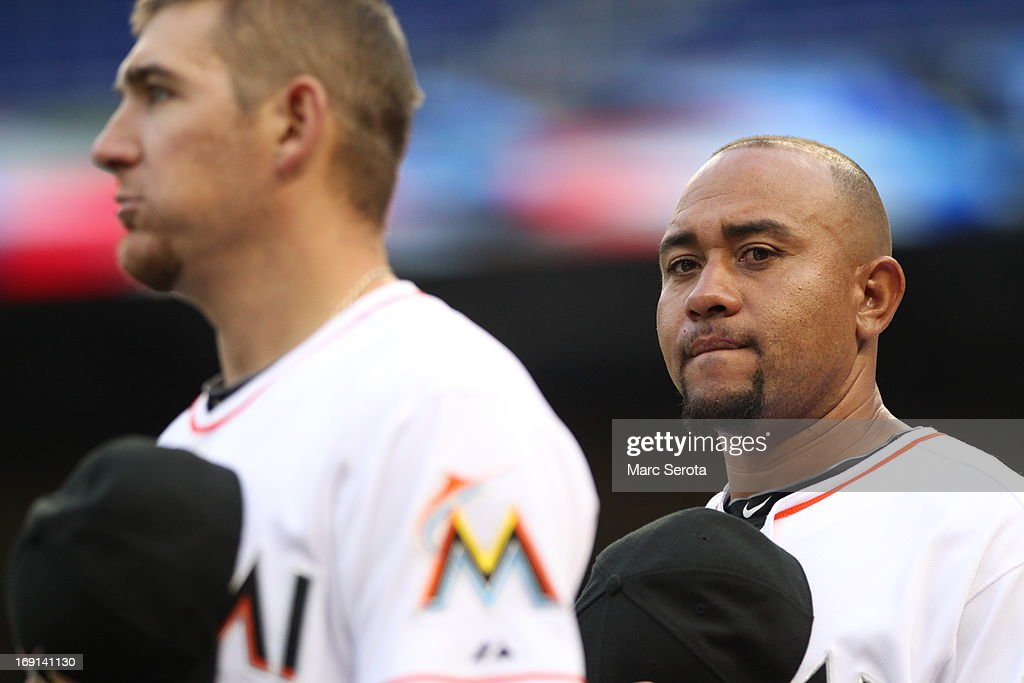Placido Polanco #30 of the Miami Marlins observes the playing of the national anthem before action against the Cincinnati Reds at Marlins Park on May 15, 2013 in Miami, Florida. The Reds defeated the Marlins 4-0.