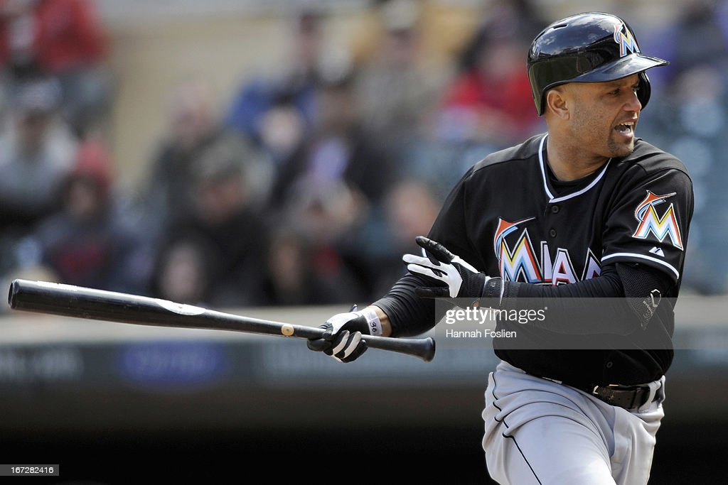 <a gi-track='captionPersonalityLinkClicked' href=/galleries/search?phrase=Placido+Polanco&family=editorial&specificpeople=213170 ng-click='$event.stopPropagation()'>Placido Polanco</a> #30 of the Miami Marlins reacts after being hit by a pitch thrown by Jared Burton #61 of the Minnesota Twins during the eighth inning of the first game of a doubleheader on April 23, 2013 at Target Field in Minneapolis, Minnesota. The Twins defeated the Marlins 4-3.