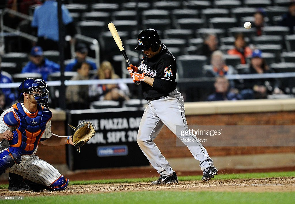 Placido Polanco #30 of the Miami Marlins reacts after being hit by a pitch during the seventh inning of game two of a doubleheader against the New York Mets on September 14, 2013 at Citi Field in the Flushing neighborhood of the Queens borough of New York City.