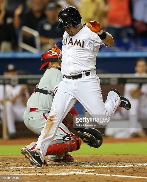 Placido Polanco of the Miami Marlins scores a run on a two RBI triple by Adeiny Hechavarria during a game against the Philadelphia Phillies at...