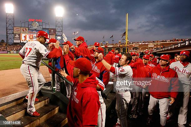 Placido Polanco of the Philadelphia Phillies celebrates in the dugout after scoring against the San Francisco Giants in the fifth inning of Game Four...