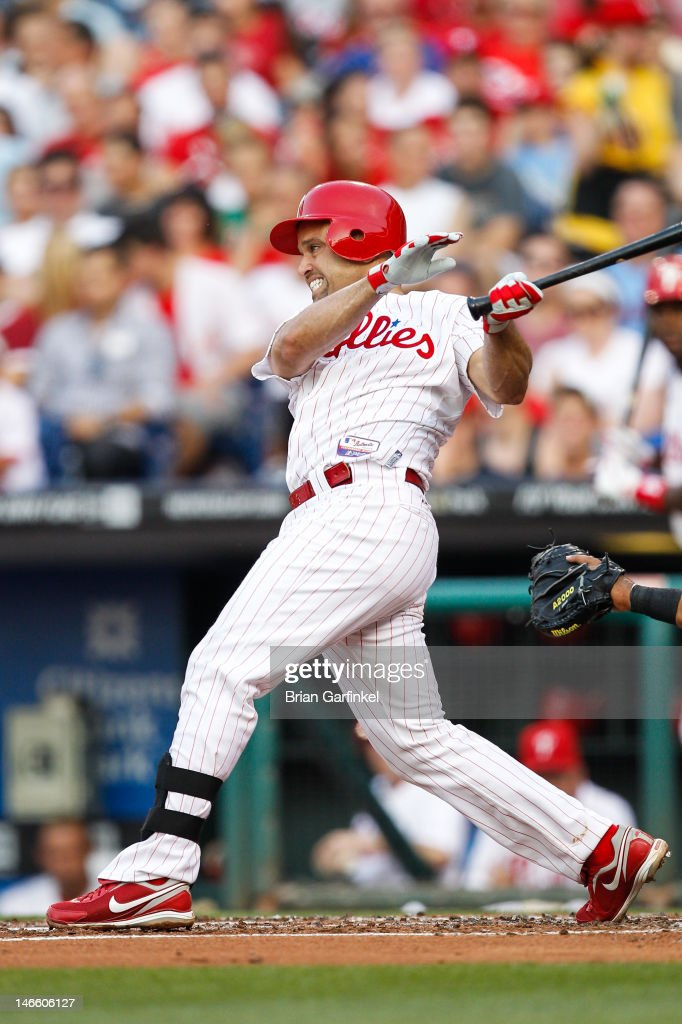 <a gi-track='captionPersonalityLinkClicked' href=/galleries/search?phrase=Placido+Polanco&family=editorial&specificpeople=213170 ng-click='$event.stopPropagation()'>Placido Polanco</a> #27 of the Philadelphia Phillies gets a base hit in the second inning of the game against the Colorado Rockies at Citizens Bank Park on June 20, 2012 in Philadelphia, Pennsylvania.
