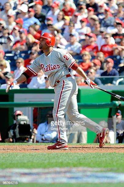 Placido Polanco of the Philadelphia Phillies hits a grand slam home run in the seventh inning against the Washington Nationals on Opening Day at...