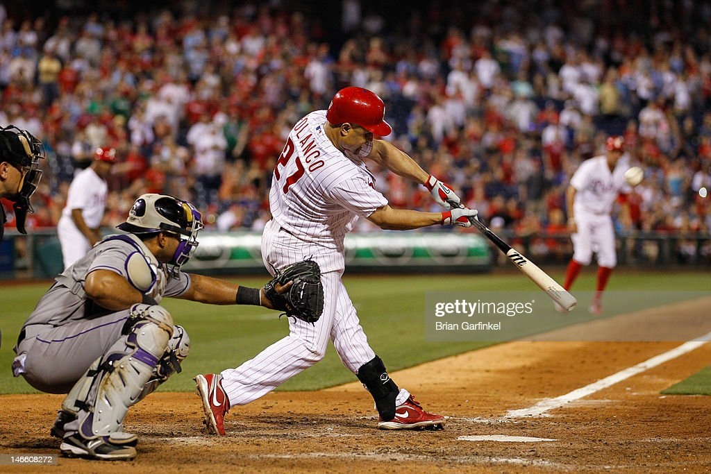 <a gi-track='captionPersonalityLinkClicked' href=/galleries/search?phrase=Placido+Polanco&family=editorial&specificpeople=213170 ng-click='$event.stopPropagation()'>Placido Polanco</a> #27 of the Philadelphia Phillies hits the ball and is safe on first on an error in the bottom of the ninth inning to allow Hunter Pence #3 to score the game winning run against the Colorado Rockies at Citizens Bank Park on June 20, 2012 in Philadelphia, Pennsylvania. The Phillies won 7-6.