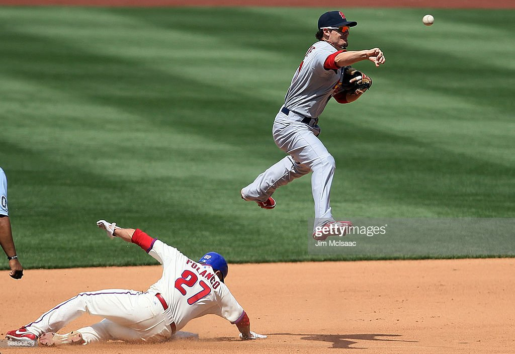Placido Polanco of the Philadelphia Phillies is forced out at second base as Tyler Greene of the St Louis Cardinals attempts a fourth inning double...