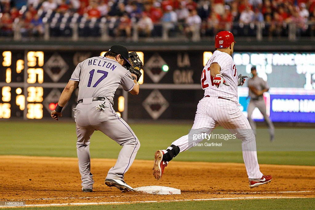 <a gi-track='captionPersonalityLinkClicked' href=/galleries/search?phrase=Placido+Polanco&family=editorial&specificpeople=213170 ng-click='$event.stopPropagation()'>Placido Polanco</a> #27 of the Philadelphia Phillies is safe on first on <a gi-track='captionPersonalityLinkClicked' href=/galleries/search?phrase=Todd+Helton&family=editorial&specificpeople=200735 ng-click='$event.stopPropagation()'>Todd Helton</a> #17 of the Colorado Rockies's error for not having his foot on the base on the last play of the game against the Colorado Rockies at Citizens Bank Park on June 20, 2012 in Philadelphia, Pennsylvania. Hunter Pence scored on the play and the Phillies won 7-6.