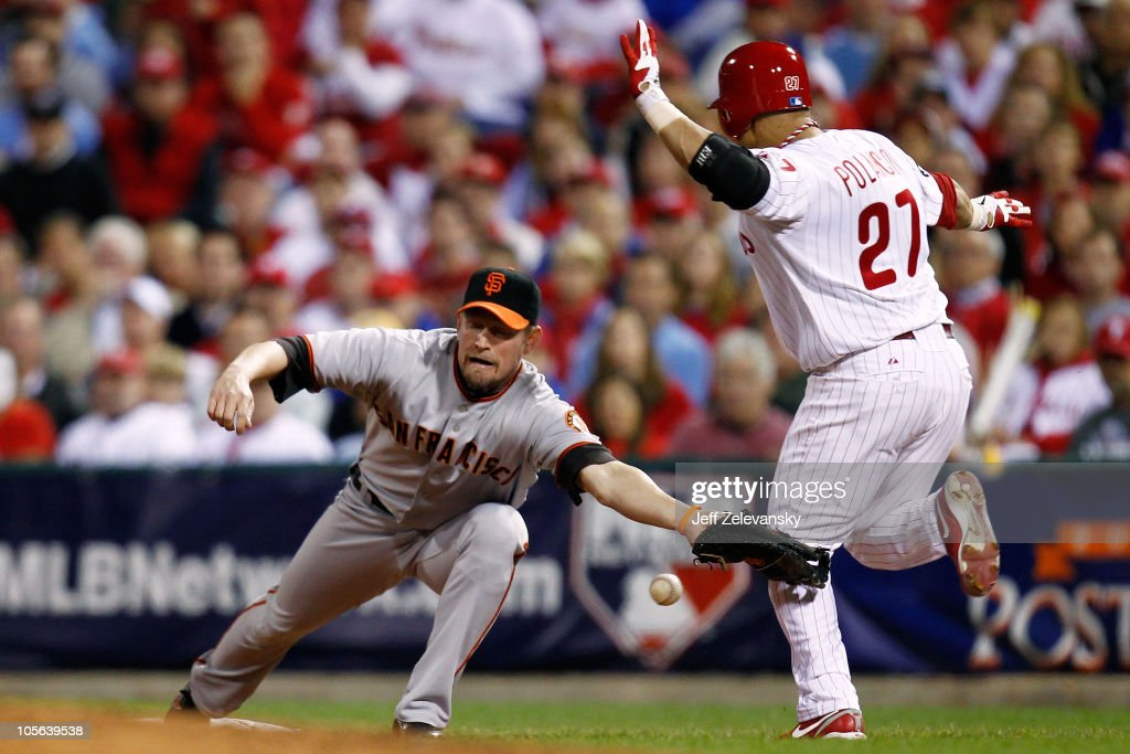 <a gi-track='captionPersonalityLinkClicked' href=/galleries/search?phrase=Placido+Polanco&family=editorial&specificpeople=213170 ng-click='$event.stopPropagation()'>Placido Polanco</a> #27 of the Philadelphia Phillies reaches first safely when <a gi-track='captionPersonalityLinkClicked' href=/galleries/search?phrase=Aubrey+Huff&family=editorial&specificpeople=208964 ng-click='$event.stopPropagation()'>Aubrey Huff</a> #17 of the San Francisco Giants can't handle a bad throw to first in Game Two of the NLCS during the 2010 MLB Playoffs at Citizens Bank Park on October 17, 2010 in Philadelphia, Pennsylvania.