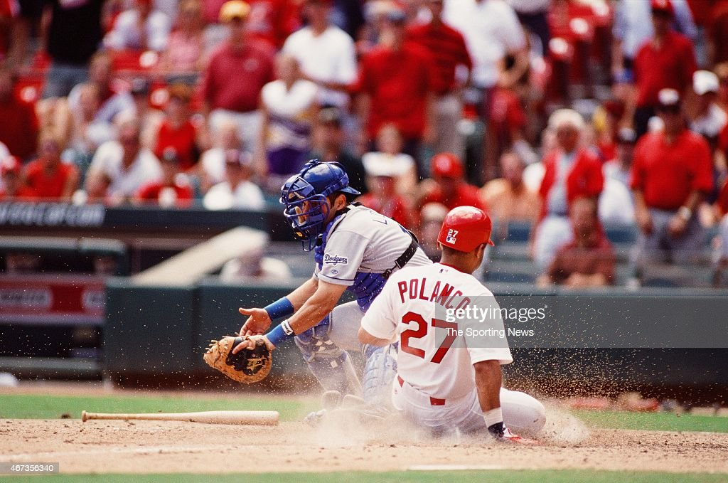 Placido Polanco of the St Louis Cardinals slides against the Los Angeles Dodgers on September 9 2001