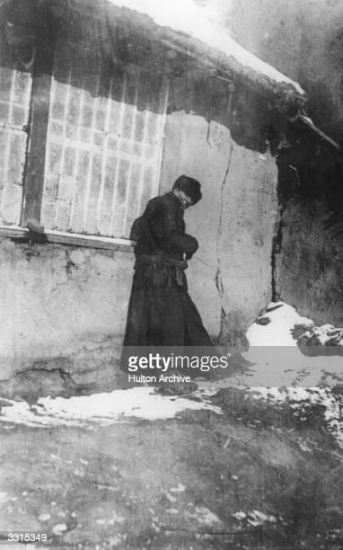 A plague victim nears the end in a street in Manchuria