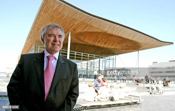 Plaid Cymru leader Ieuan Wyn Jones poses for the media in front of the Senedd Building in Cardiff Wales after being appointed Deputy First Minister...