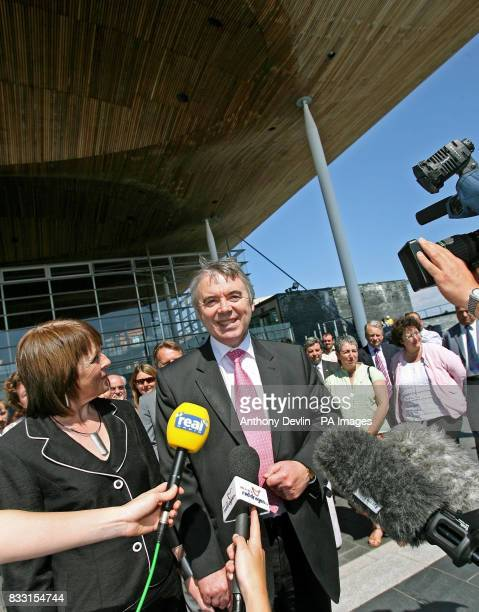 Plaid Cymru leader Ieuan Wyn Jones stands with his wife Eirian Jones as he talks to the media in front of the Senedd Building in Cardiff Wales after...