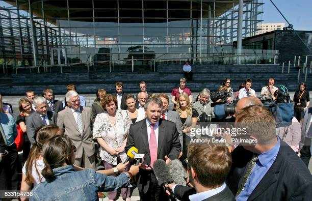 Plaid Cymru leader Ieuan Wyn Jones talks to the media in front of the Senedd Building in Cardiff Wales after being appointed Deputy First Minister...