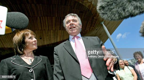 Plaid Cymru leader Ieuan Wyn Jones talks to the media with his wife Eirian Jones in front of the Senedd Building in Cardiff Wales after being...