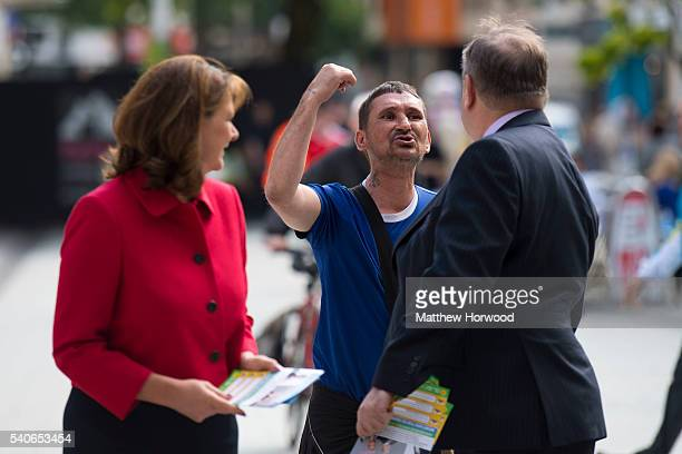 Plaid Cymru Leader Leanne Wood and former First Minister of Scotland Alex Salmond MP are shouted at by a member of the public during a rally on Queen...