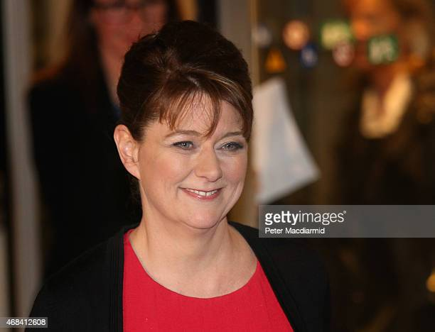 Plaid Cymru party leader Leanne Wood leaves MediaCityUK after appearing in the leaders election debate on April 2 2015 in Manchester England A...