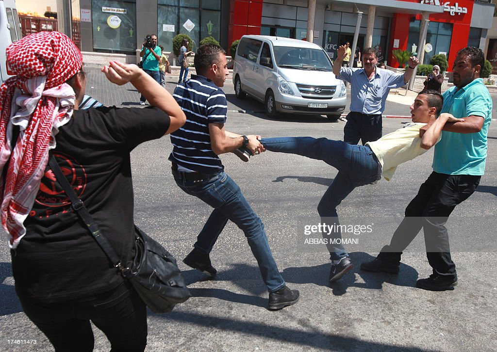 Plain clothed Palestinian police arrest a protester demonstrating against the upcoming negotiations between Palestinian leaders and Israel, as they try to march towards the headquarters of Palestinian president Mahmud Abbas, in the West Bank city of Ramallah on July 28, 2013. A Palestinian official told AFP that the US-brokered renewal of peace talks, stalled since September 2010, would open in Washington this coming week.