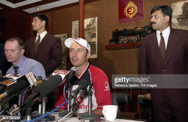 Plain clothes police officers guard England captain Nasser Hussain with Andrew Walpole England Media Relations Manager at a press conference in the...