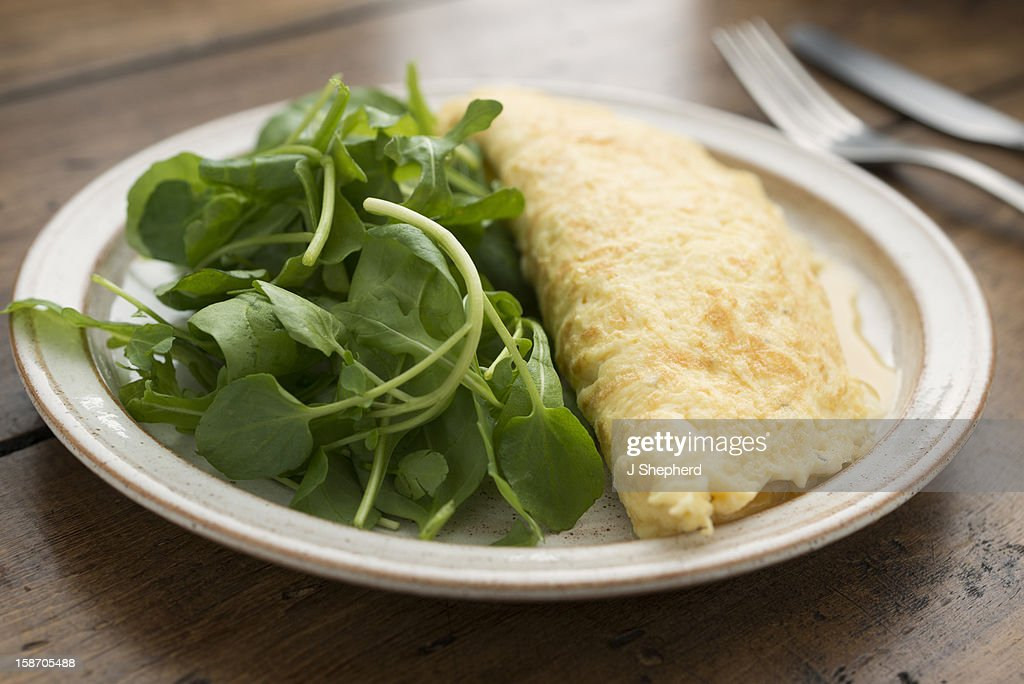 Plain omelette and salad : Stock Photo