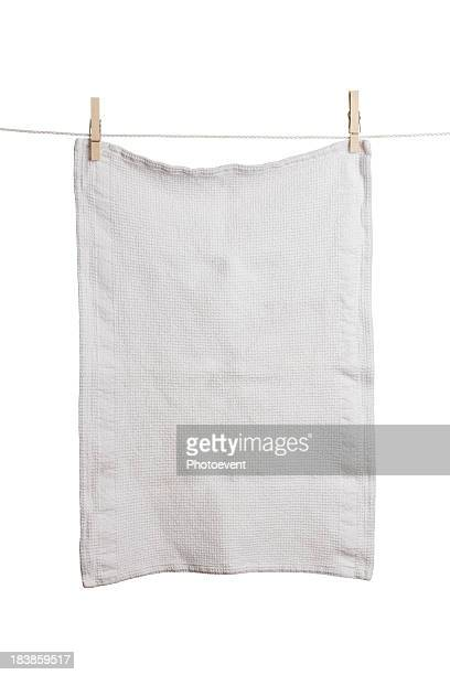 A plain white dish towel hanging on a line
