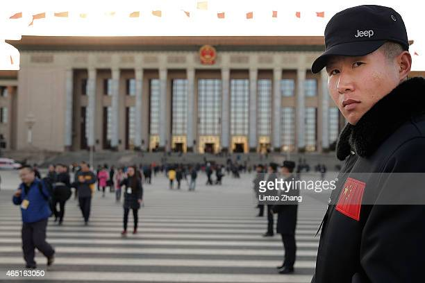 A plainclothes policeman guards outside Great Hall of the People after the opening session of the Chinese People's Political Consultative Conference...