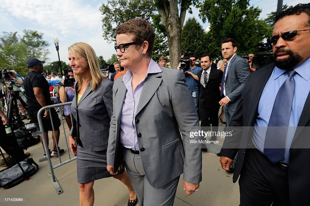 Plaintiff couple in the Proposition 8 case before the U.S. Supreme Court Sandy Stier (L) and Kris Perry (C) arrive to the U.S. Supreme Court building June 24, 2013 in Washington DC. The high court is expected to rule this week on some high profile decisions including California's Proposition 8, the controversial ballot initiative that defines marriage as between a man and a woman.