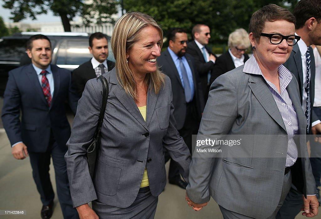 Plaintiff couples in the Proposition 8 case before the U.S. Supreme Court Sandy Stier (2nd R), Kris Perry (R), Paul Katami (L) and Jeff Zarillo (2nd L) walk up to the the U.S. Supreme Court building June 24, 2013 in Washington DC. The high court is expected to rule this week on California's Proposition 8, the controversial ballot initiative that defines marriage as between a man and a woman.