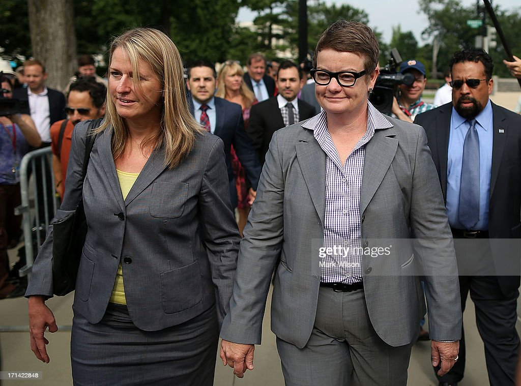 Plaintiff couples in the Proposition 8 case before the U.S. Supreme Court Sandy Stier, (L) Kris Perry (R), Paul Katami, (2nd L) and Jeff Zarillo (2nd R) walk up to the the U.S. Supreme Court building June 24, 2013 in Washington DC. The high court is expected to rule this week on California's Proposition 8, the controversial ballot initiative that defines marriage as between a man and a woman.