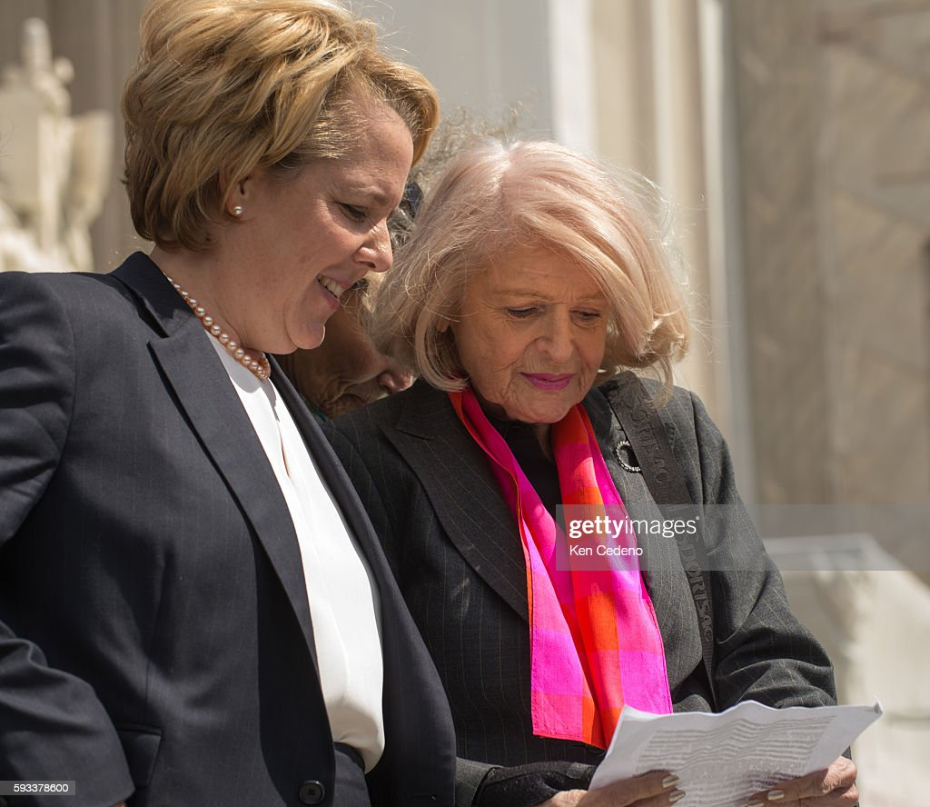 Plaintiff Edith Windsor right goes over notes before speaking to the media in front of the Supreme Court in Washington DC March 27 2013 The US...