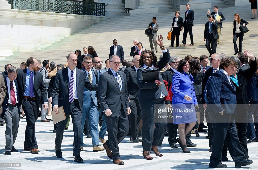 Plaintiff James Obergefell in the Obergefell v Hodges case walks alongside other plaintiffs outside the US Supreme Court on April 28 2015 in...