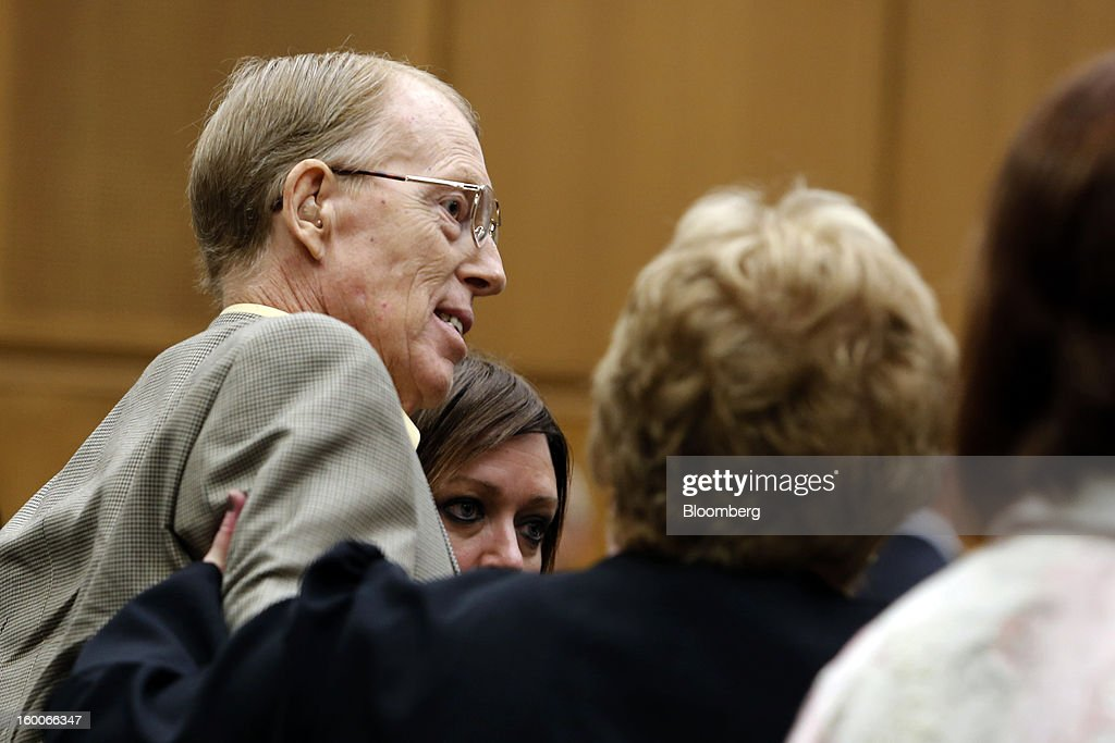 Plaintiff Loren Kransky is helped to his feet by family members during the trial of Kransky v. DePuy, at California Superior Court in Los Angeles, California, U.S., on on Friday, Jan. 25, 2013. Johnson & Johnson failed to warn doctors of the risks of defective metal hip implants that it didn't test properly, Kransky's lawyer told a Los Angeles jury in the first of 10,000 lawsuits over the device to go to trial. Photographer: Patrick T. Fallon/Bloomberg via Getty Images