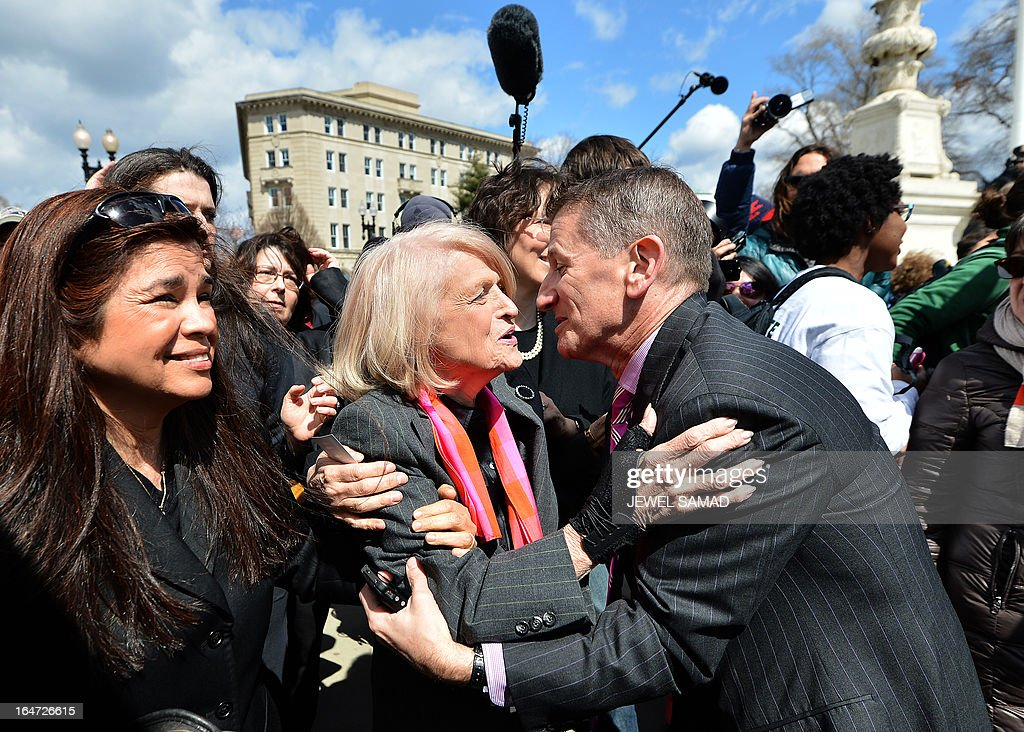 Plaintiff of the US v. Windsor case challenging the constitutionality of Section 3 of the Defense of Marriage Act (DOMA), 83-year-old lesbian widow Edie Windsor (C), greets same-sex marriage supporters as she leaves the Supreme Court on March 27, 2013 in Washington, DC. The US Supreme Court tackled same-sex unions for a second day Wednesday, hearing arguments for and against the 1996 US law defining marriage as between one man and one woman. After the nine justices mulled arguments on a California law outlawing gay marriage on Tuesday, they took up a challenge to the constitutionality of the federal Defense of Marriage Act (DOMA). The 1996 law prevents couples who have tied the knot in nine states -- where same-sex marriage is legal -- from enjoying the same federal rights as heterosexual couples. AFP PHOTO/Jewel Samad