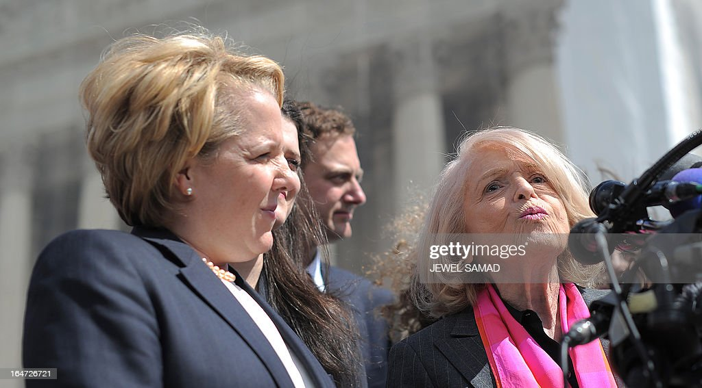 Plaintiff of the US v. Windsor case challenging the constitutionality of Section 3 of the Defense of Marriage Act (DOMA), 83-year-old lesbian widow Edie Windsor (R) makes a statement to the media as her lawyer Roberta Kaplan (L) looks on in front the Supreme Court on March 27, 2013 in Washington, DC. The US Supreme Court tackled same-sex unions for a second day Wednesday, hearing arguments for and against the 1996 US law defining marriage as between one man and one woman. After the nine justices mulled arguments on a California law outlawing gay marriage on Tuesday, they took up a challenge to the constitutionality of the federal Defense of Marriage Act (DOMA). The 1996 law prevents couples who have tied the knot in nine states -- where same-sex marriage is legal -- from enjoying the same federal rights as heterosexual couples. AFP PHOTO/Jewel Samad
